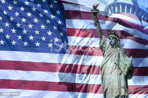 istock Liberty statue and american flag 538814689