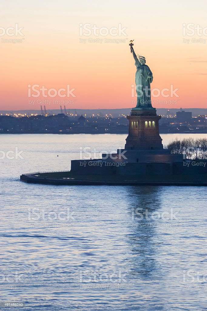 Liberty Statue and powerboat stock photo