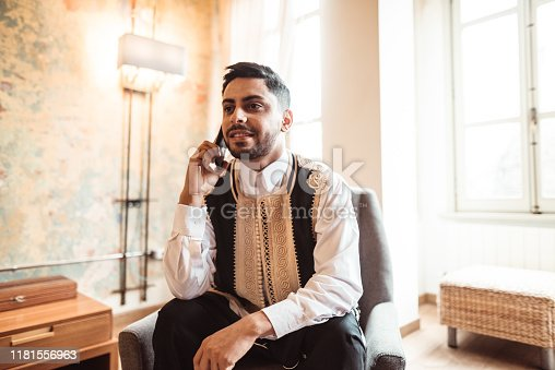 libic man using the smartphone at home