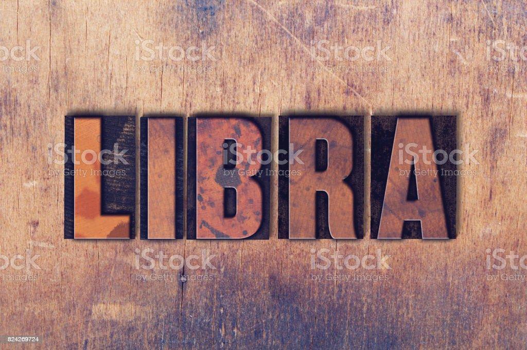 Libra Theme Letterpress Word on Wood Background stock photo