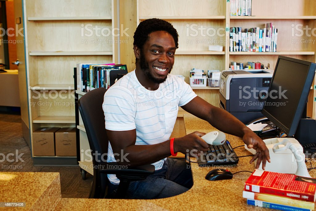 Librarian checking in books stock photo