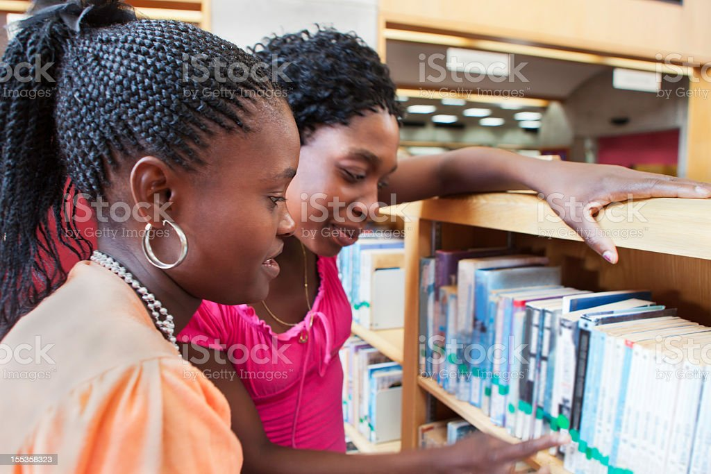 Librarian helping student stock photo