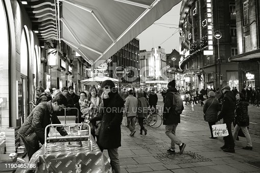 Strasbourg, France - Dec 27, 2017: Librarie Library book store Kleber exterior wraping gifts stand during winter holiday witih people waiting in queue to get their gifts prepared - black and white image