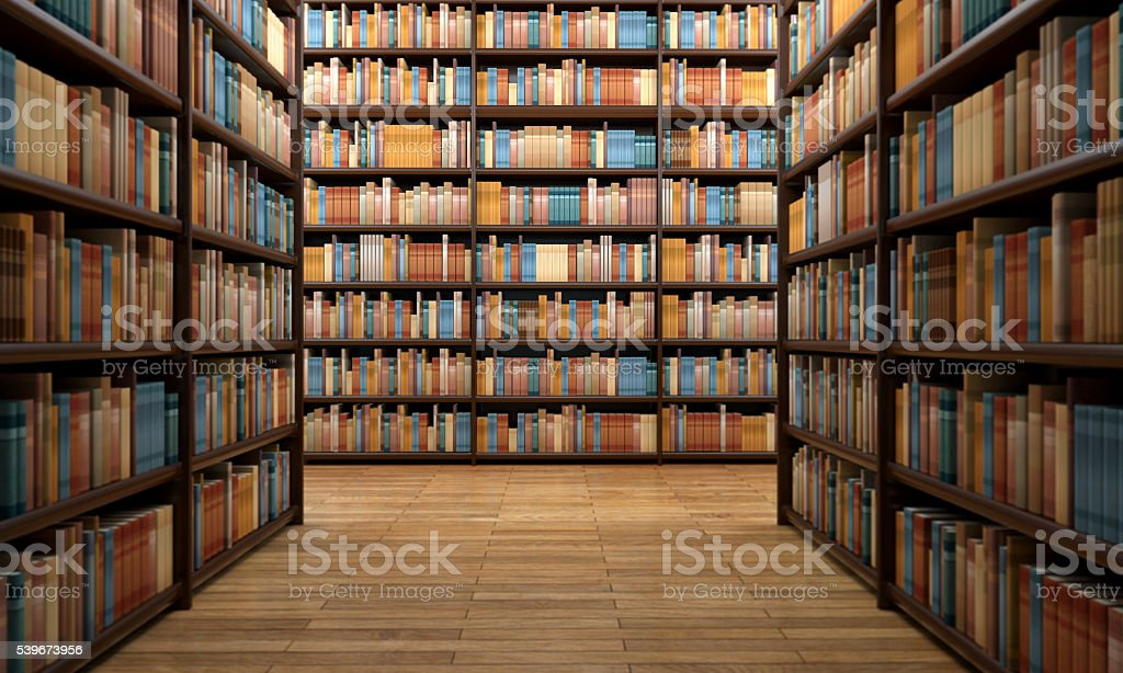 Library aisle with wooden shelves and hundreds of books stock photo