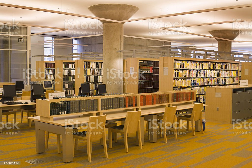 Library Interior Featuring Computers, Tables, Books, Shelves,  Chairs, Reading Areas royalty-free stock photo