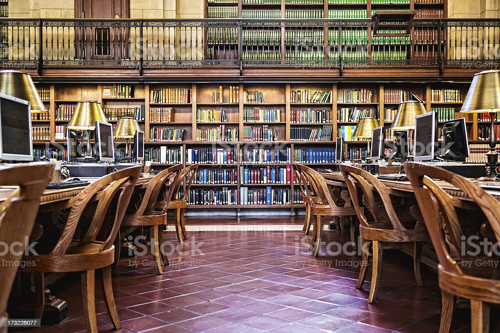 Library interior with bookshelves and computers stock photo