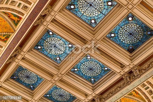Great Hall. View of the ceiling and cove. Showcasing the aluminum plating, stained glass windows, and murals. Library of Congress Thomas Jefferson Building, Washington, D.C.