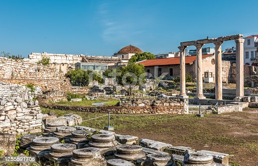 Library of Hadrian in Athens, Greece. It is famous tourist attraction of Athens. Scenic view of Hadrian building, classical Greek ruins, remains of ancient Athens city. Travel and history concept.