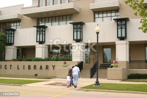 A grandmother is bringing two grandchildren to the library