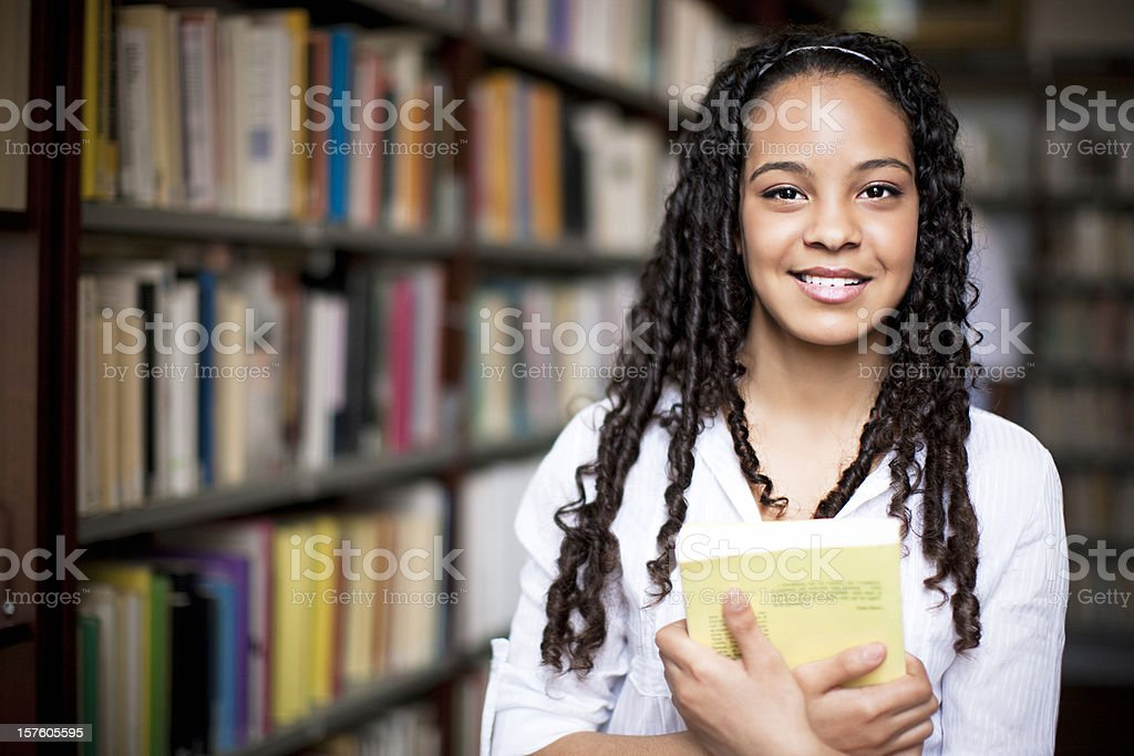 Library Girl in the library.  Adult Stock Photo