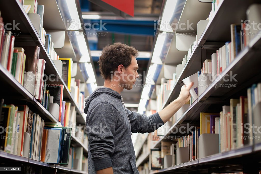 library student in book shop or lbrary Adult Stock Photo