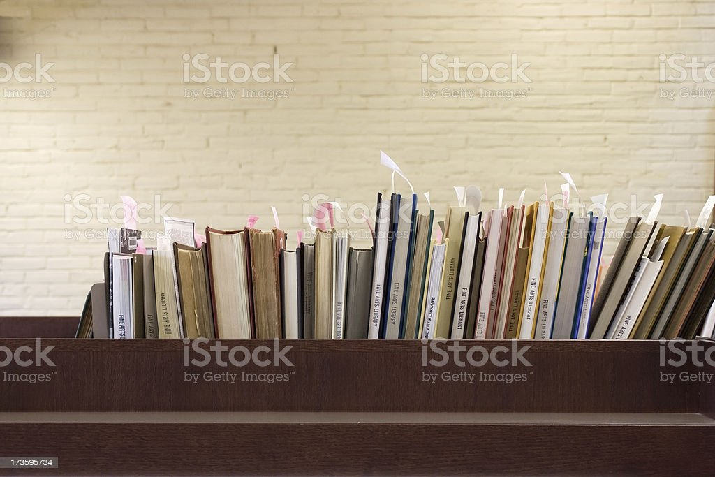 Library shelf with books. Selective focus on the books.Related images...