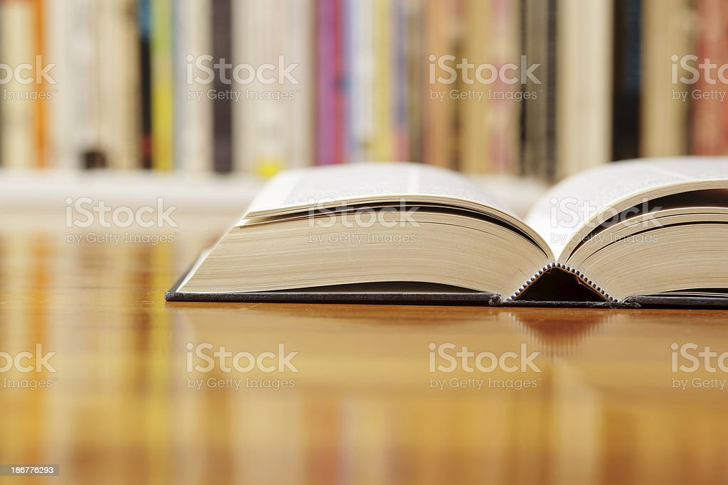 Library table with books laying out royalty-free stock photo