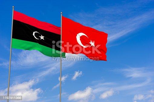 Libya and Turkey flags over blue sky background. 3D illustration