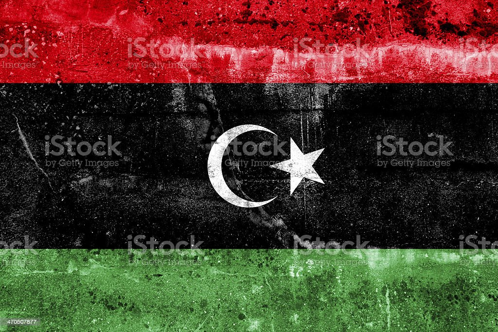 Libya Flag painted on grunge wall stock photo
