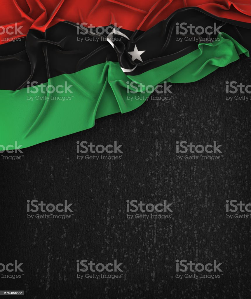 Libya Flag Vintage on a Grunge Black Chalkboard With Space For Text royalty-free stock photo