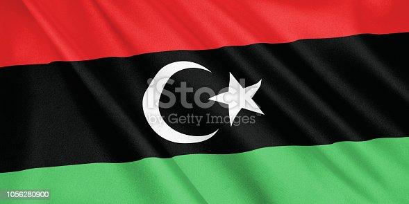 1056280906 istock photo Libya flag waving with the wind, wide format, 3D illustration. 3D rendering. 1056280900