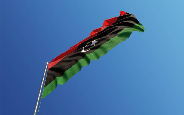 Libyan Flag Waving With Wind On Blue Sky stock photo