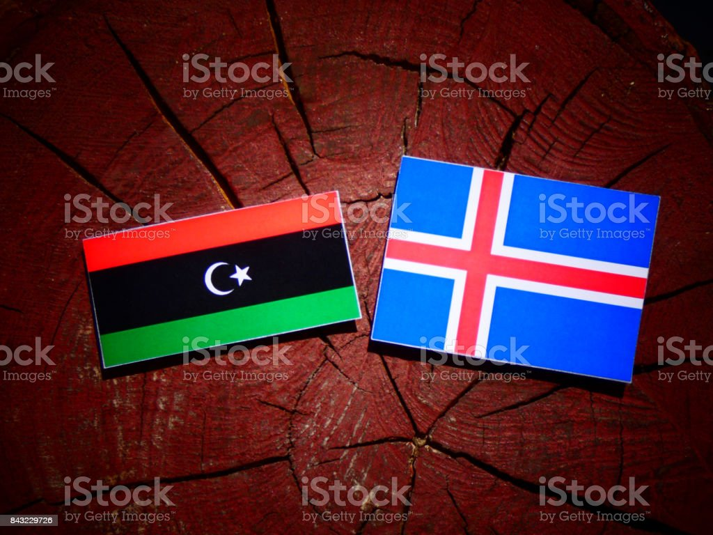 Libyan flag with Icelandic flag on a tree stump isolated stock photo
