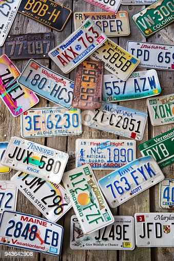 Bar Harbor, Maine, USA - AUGUST 28: Old car license plates displayed  on a wall in Bar Harbor. In the United States, each jusirsdiction has a unique design, usually displaying a symbol of the issuing state. August 28, 2014