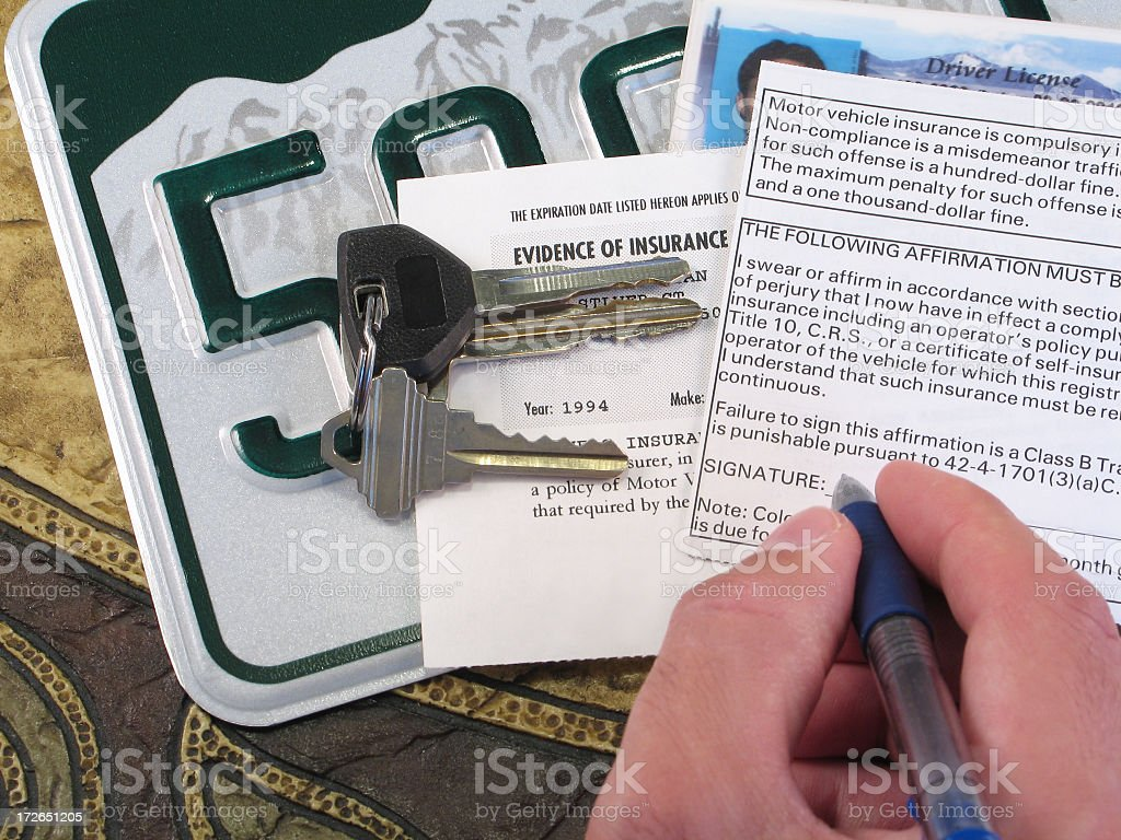 License Plate, Keys, and Papers Proving Evidence of Auto Insurance stock photo