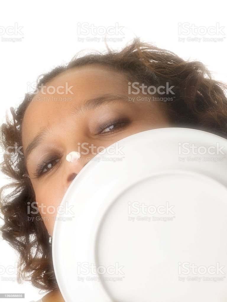 Licking the plate royalty-free stock photo
