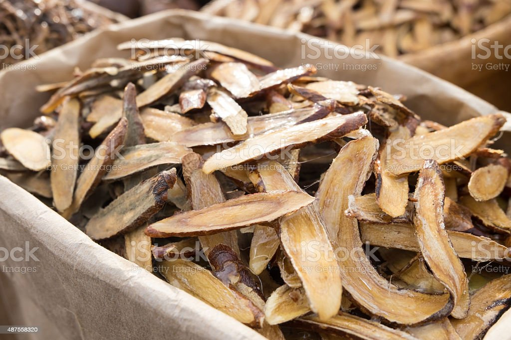 Licorice herbal dry out in wooden sliced on the table stock photo