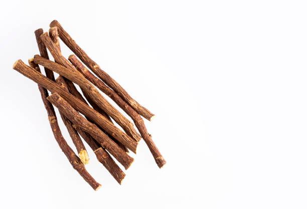 licorice roots - glycyrrhiza glabra - white background - liquirizia foto e immagini stock
