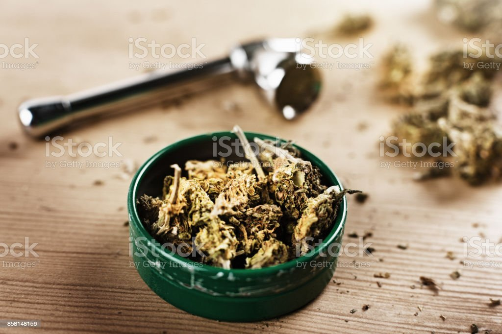 Lid of cannabis with pipe stock photo