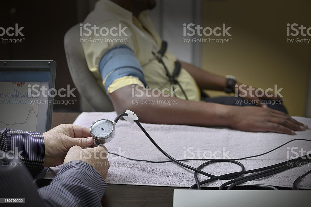 Lie detection with polygraph stock photo