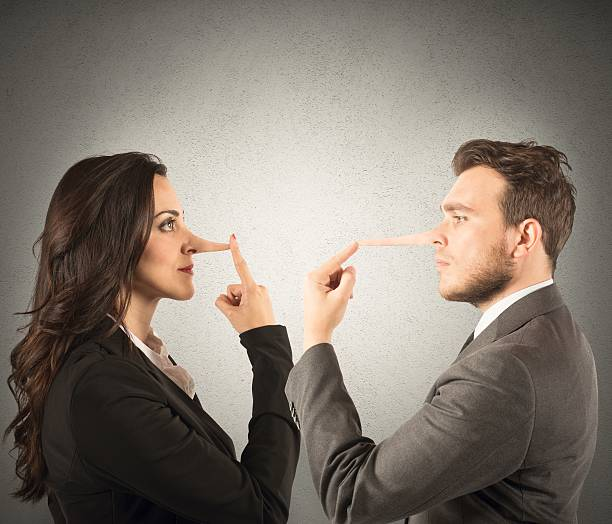 Lie Concept of lie with couple with long nose pinocchio stock pictures, royalty-free photos & images