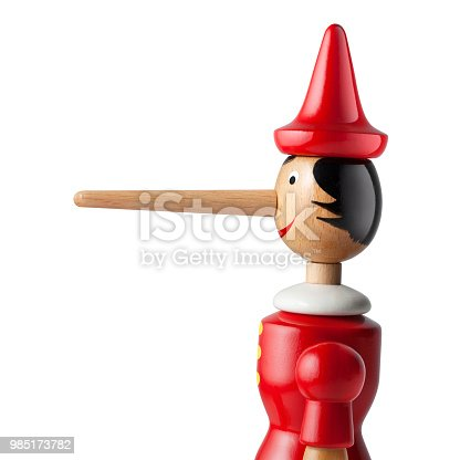 Lie. Pinocchio with a long nose on white background.