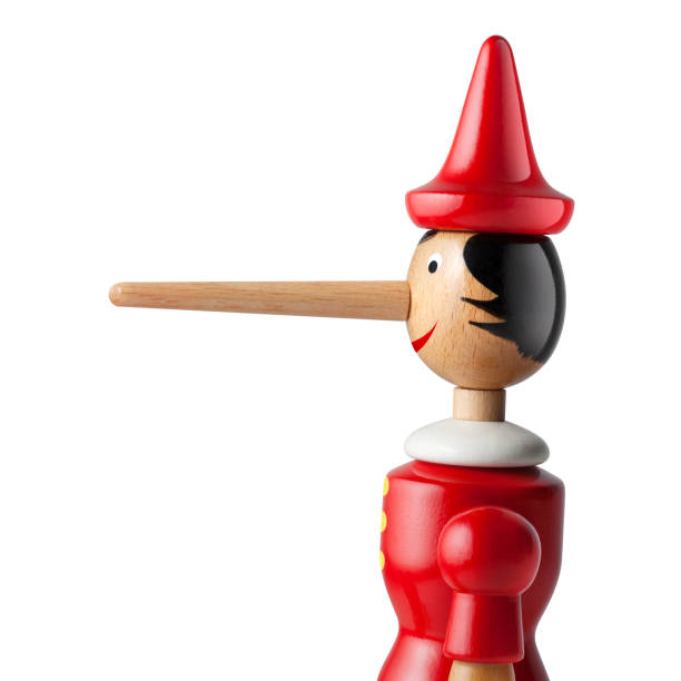 Lie. Pinocchio with a long nose on white background. Lie. Pinocchio with a long nose on white background. pinocchio stock pictures, royalty-free photos & images