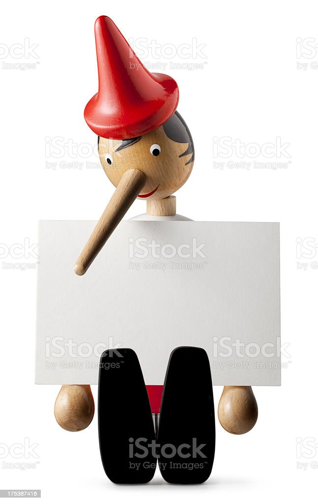Lie. Pinocchio with a long nose. stock photo