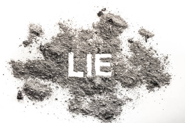 lie word written in ash, dust, sand - disingenuous stock pictures, royalty-free photos & images