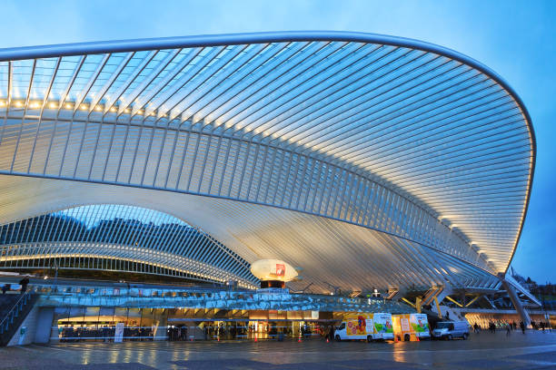 Liege outside front Beautiful view of the modern architecture railway station Liege-Guillemins with steel shapes and lines in the blue hour in Belgium lulik stock pictures, royalty-free photos & images