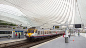 LIEGE, BELGIUM - AUG 5, 2014: The Liege-Guillemins railway station. This station is made of steel, glass and white concrete designed by Spanish architect Santiago Calatrava.