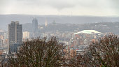 Beautiful cityscape panorama aerial view of the skyline of Liege, Belgium, with station Liege-Guillemins on a rainy winter day seen from the top of the Montagne de Bueren