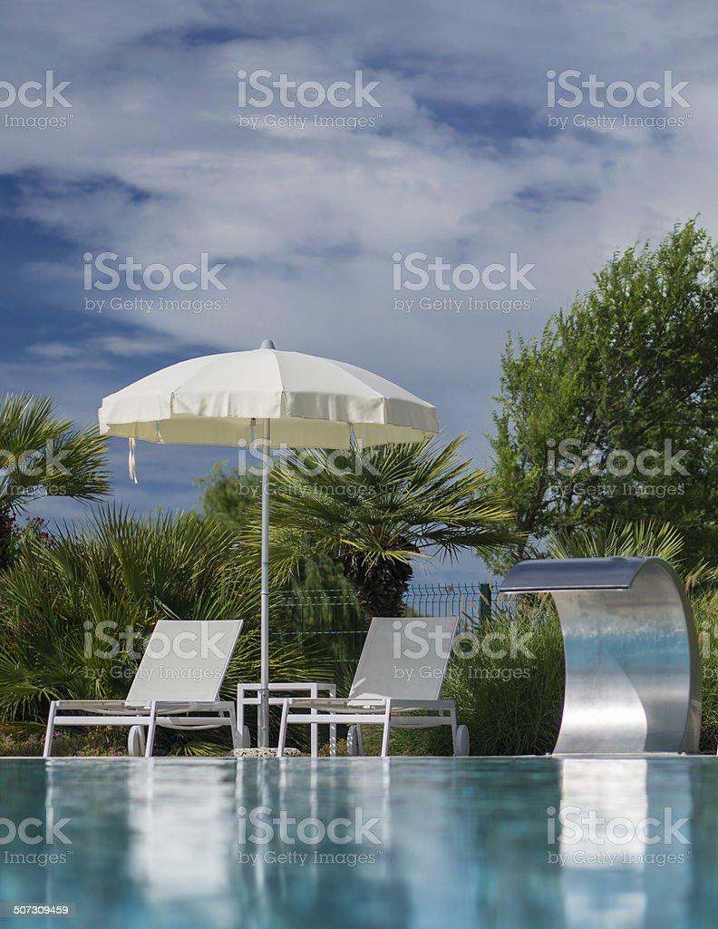 Liegen am Pool stock photo