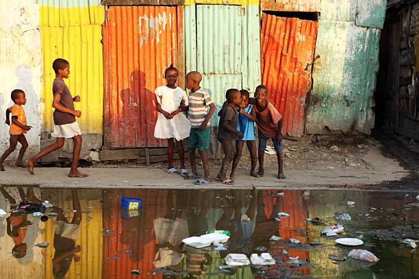 Life after the Earthquake, Haiti Port-Au-Prince, Haiti - February 13th, 2010 : Haitian children playing together near an open bazaar street.  haitian ethnicity stock pictures, royalty-free photos & images
