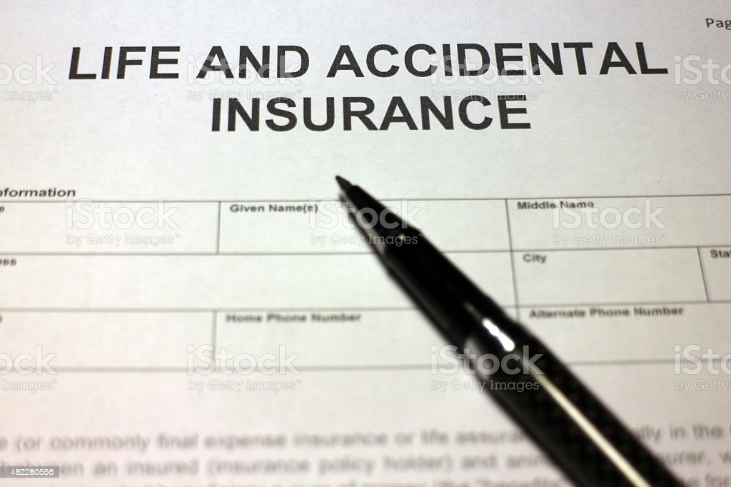 Someone filling out Life and Accidental Insurance form.