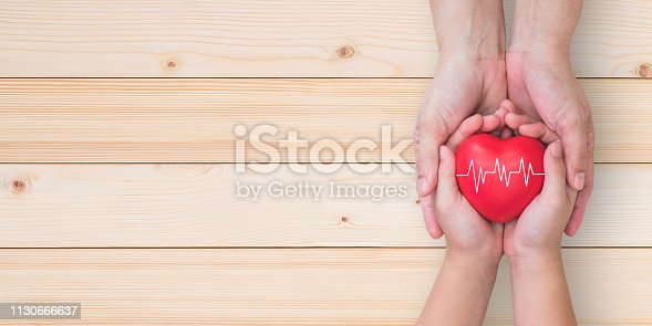 Life and health insurance, pediactric nursing care and childhood cardiovascular heart disease, healthcare concept with child and family parent supporting heart with pulse sign