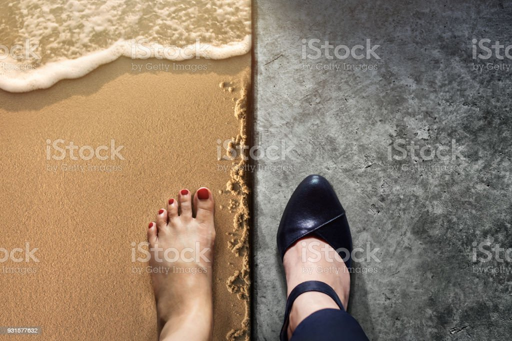 Life Balance concept for Work and Travel present in Top view position by half of Business Working Woman Shoes on Cement Floor and Female's Barefoot on Sand Beach stock photo