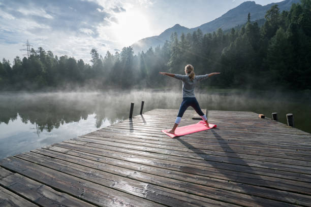 Life balance, people exercising yoga stock photo