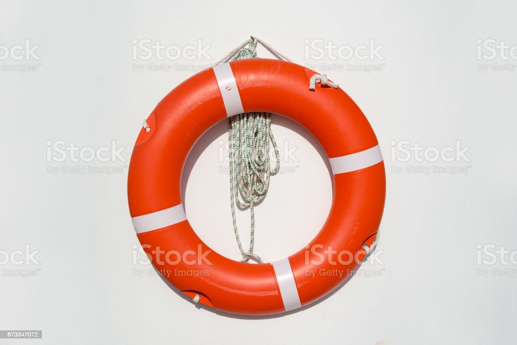 life belt hanging on white wall at the pool stock photo