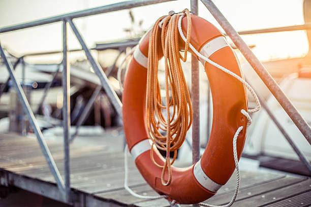 life belt - life ring in pier - livbåt bildbanksfoton och bilder