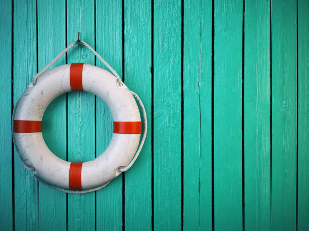 Life belt or rescue ring on wooden wall. Salvation, protection stock photo