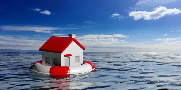 rettungsring und ein kleines haus am blauen meer hintergrund. 3d illustration - wasser sicherheitsausrüstung stock-fotos und bilder