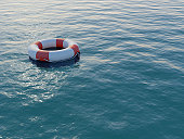 istock Life buoy floating on a rippled sea 157313907