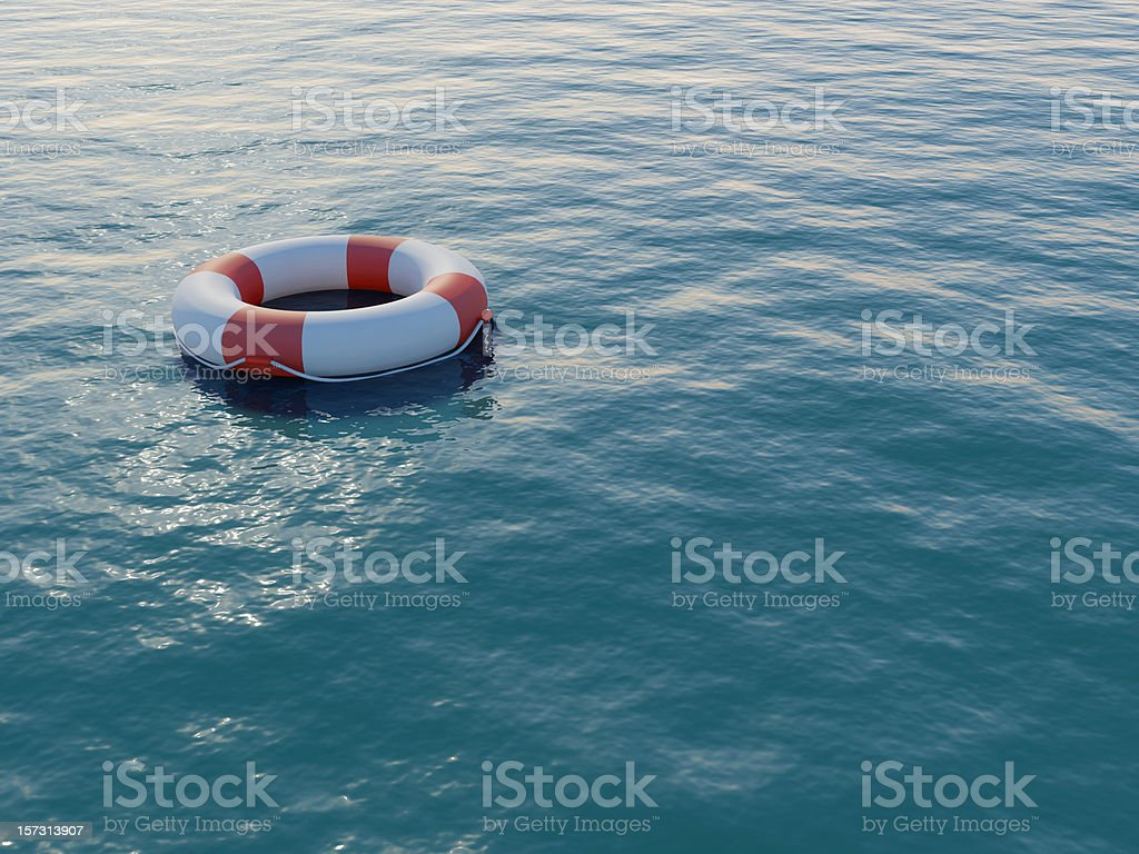 Life buoy floating on a rippled sea stock photo